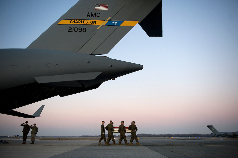 The remains of US Marine Corps Lance Corporal Mark D. Juarez of San Antonio, Texas are transfered from a C17 aircraft by a Marine Corps transfer team after arriving at Dover Air Force Base in Dover, DE, on January 12, 2010.  Lance Corporal  Juarez was killed while serving in Afghanistan.