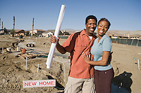 Mid adult couple in construction site of their new home