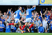 Portsmouth's Marc McNulty celebrates scoring the opening goal to give the home team a 1-0 lead during the Sky Bet League 2 play-off first leg match between Portsmouth and Plymouth Argyle at Fratton Park, Portsmouth, England on 12 May 2016. Photo by Graham Hunt.