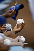 May 12, 2007: Fans  hold out baseballs for autographs as the Los Angeles Dodgers defeated the Cincinnati Reds 7-3 at Dodger Stadium in Los Angeles, CA.