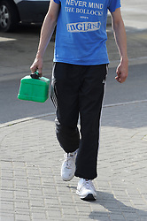 NOTE TO EDITORS - WRITING ON TSHIRT © Licensed to London News Pictures. 30/03/2012. Petrol Panic buying today 30.03.2012. Man filling a Jerry can at the BP garage on the A21 Lamberhurst Quarter, Kent. Photo credit : Grant Falvey/LNP