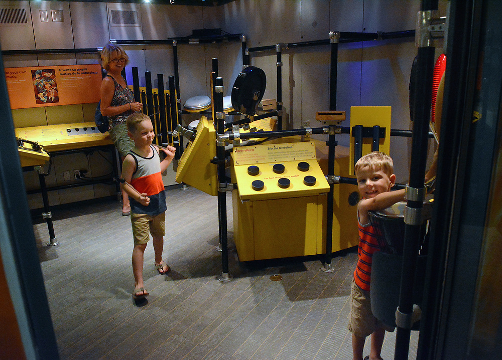 jt062717h/arts/jim thompson/ left to right- Norma-Jean Baxter rock out with her grandkids Cael and Owen Doxtator in the Jamming Room which is one of the hands-on exhibits of the Wild Music: Sounds and Songs of Life Exhibit at the New Mexico Museum of Natural History and Science.Tuesday June. 27, 2017. (Jim Thompson/Albuquerque Journal)