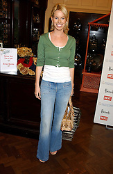 CAROLINE HABIB at a fashion show featuring designs by Diesel Kid's FW05 collection held in The Georgian Restaurant at Harrod's on 1st September 2005.  Proceeds from the event went to the Graet Ormond Street Hospital.<br />