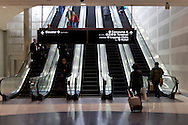 Detroit, Michigan - People use the escaltors at Detroit Metropolitan Airport on Feb. 3, 2013.