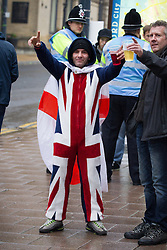 © Licensed to London News Pictures . 12/10/2013 . Bradford , UK . An EDL supporter wearing a Union Jack onesie . The EDL hold a demonstration in Bradford today (Saturday 12th October 2013) . It is their first demonstration since leaders Stephen Yaxley-Lennon (aka Tommy Robinson ) and Kevin Carroll quit . Approximately 500 protesters gathered near the city centre . Photo credit : Joel Goodman/LNP