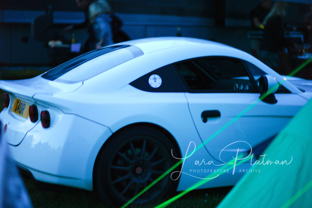 Ginetta prototype and concept cars in the campsite at twilight