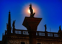 """The sun silhouettes patron Saint Teodoro while protecting Saint Mark's Square Venice""..."