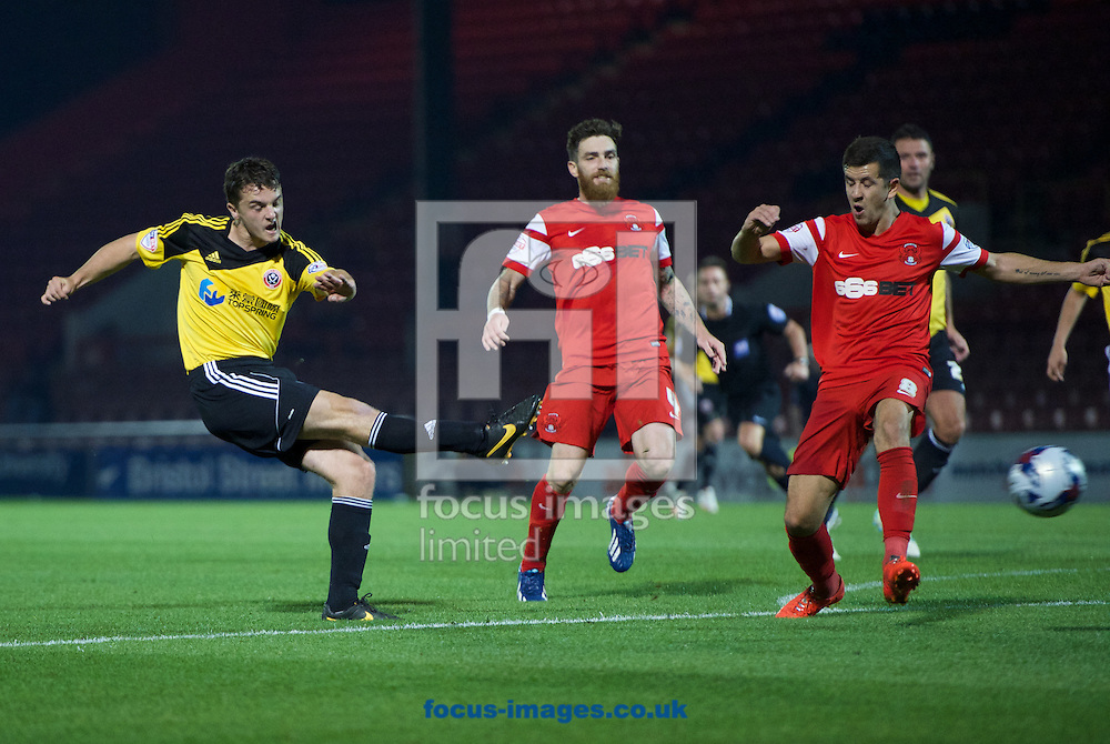 Stephen McGinn of Sheffield United has a shot on goal during the Capital One Cup match at the Matchroom Stadium, London<br /> Picture by Alan Stanford/Focus Images Ltd +44 7915 056117<br /> 23/09/2014