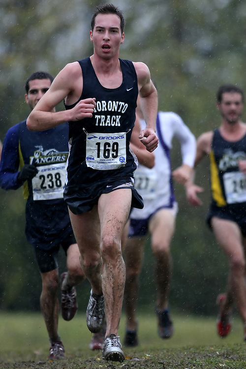 (Kingston, ON---25 October 2008) Etienne Bredin of TORONTO University running to finish 15 in the 2008 Ontario University Athletics men's cross country championship.  Photograph copyright Sean Burges/Mundo Sport Images (www.msievents.com).
