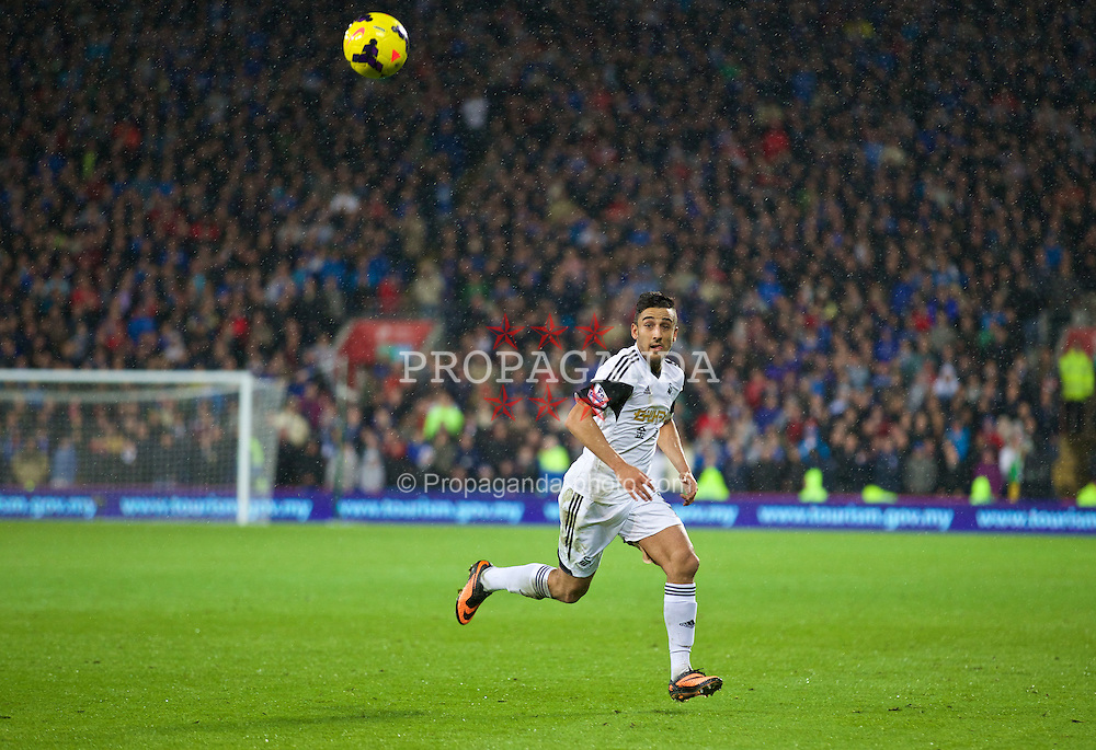 CARDIFF, WALES - Sunday, November 3, 2013: Swansea City's Neil Taylor in action against Cardiff City during the Premiership match at the Cardiff City Stadium. (Pic by David Rawcliffe/Propaganda)