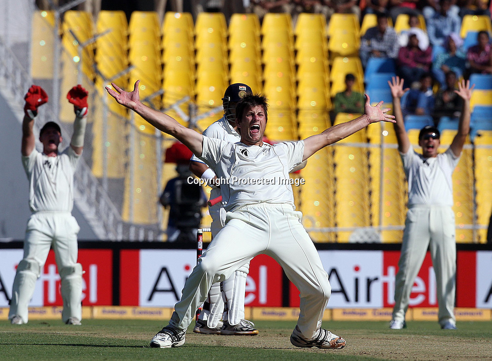New Zealand's Hamish Bennett , right, appeals unsuccessfully for the wicket of India's Gautam Gambhir, left rear, during the first day of their first cricket test match, in Ahmadabad, India, Thursday, Nov. 4, 2010