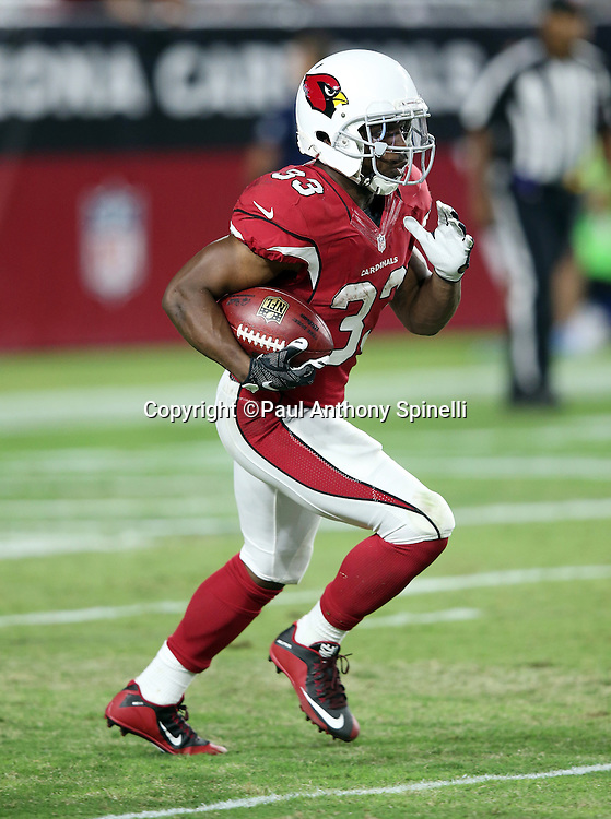 Arizona Cardinals kick returner and running back Kerwynn Williams (33) returns a kick during the 2015 NFL preseason football game against the San Diego Chargers on Saturday, Aug. 22, 2015 in Glendale, Ariz. The Chargers won the game 22-19. (©Paul Anthony Spinelli)