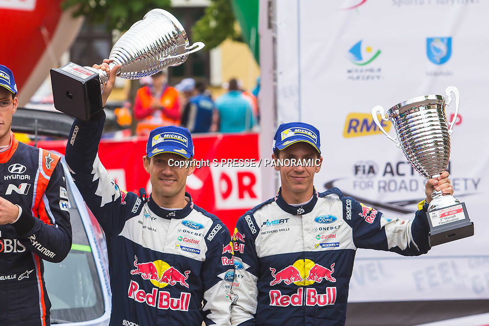 Sebastien Ogier	and Julien Ingrassia on the podium for 3rd place.<br />