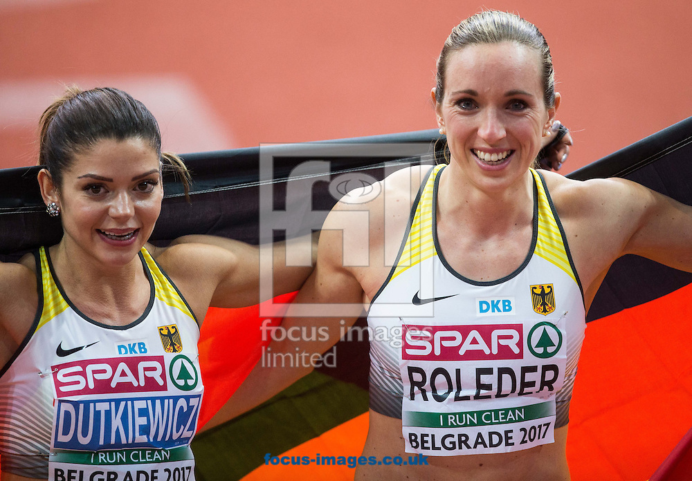 Winner Cindy Roleder of Germany (R) and third placed Pamela Dutkiewicz of Germany celebrate after the 60m Hurdles Women Final on day one of the 34th European Indoor Athletics Championships Belgrade 2017 at the Kombank Arena, Belgrade<br /> Picture by EXPA Pictures/Focus Images Ltd 07814482222<br /> 03/03/2017<br /> *** UK &amp; IRELAND ONLY ***<br /> <br /> EXPA-SLO-170303-0009.jpg