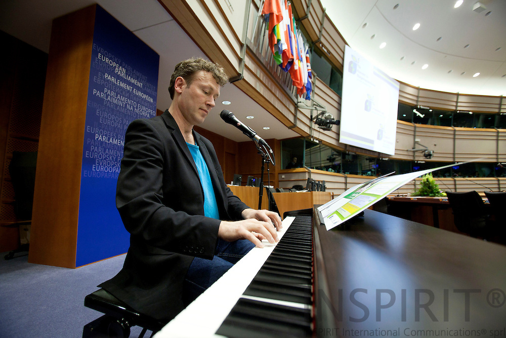 BRUSSELS - BELGIUM - 04 MAY 2010 -- Covenant of Mayors Cermony in the EU-Parliament -- From left Musician Soeren Eppler playing piano and singing in the European Parliament. PHOTO: ERIK LUNTANG / INSPIRIT Photo..