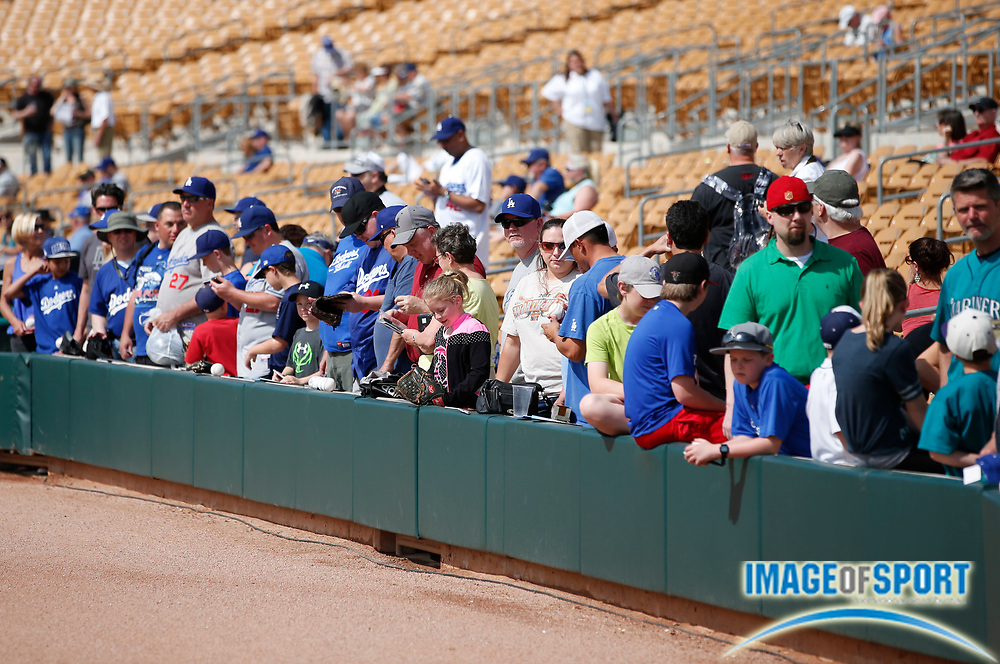 Mar 4, 2014; Glendale, AZ, USA; Fans seeking autographs at Camelback Ranch stadium prior to game between the Seattle Mariners and the Los Angeles Dodgers.