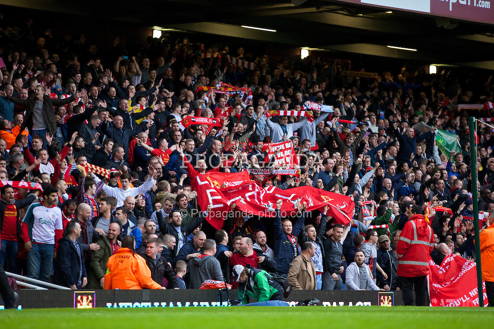 LONDON, ENGLAND - Sunday, April 6, 2014: Liverpool's supporters celebrate after beating West Ham United 2-1 during the Premiership match at Upton Park. (Pic by David Rawcliffe/Propaganda)
