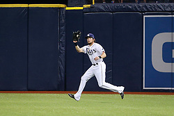 May 9, 2017 - St. Petersburg, Florida, U.S. - WILL VRAGOVIC   |   Times.Tampa Bay Rays center fielder Colby Rasmus (28) gets under the fly ball by Kansas City Royals left fielder Alex Gordon (4) in the second inning of the game between the Kansas City Royals and the Tampa Bay Rays at Tropicana Field in St. Petersburg, Fla. on Tuesday, May 9, 2017. (Credit Image: © Will Vragovic/Tampa Bay Times via ZUMA Wire)