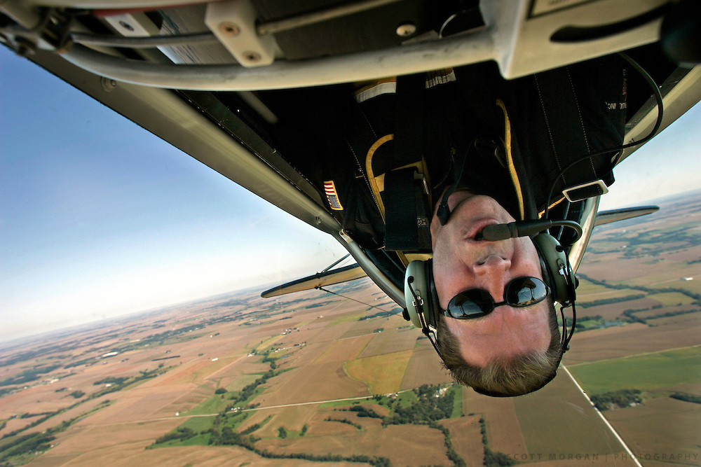 Pilot Jon Melby of Chandler, Ariz., flys upside down in his Pitts S2B airplane Friday, Sept. 17, 2004, on a practice run over Illinois before the Burlington Air Show on Saturday. Scott Morgan | The Hawk Eye