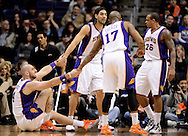 Jan. 14, 2013; Phoenix, AZ, USA; Phoenix Suns center Marcin Gortat (4) is helped up by teammates forward Luis Scola (14) , guard Shannon Brown (26) and forward P.J. Tucker (17) during the game against the Oklahoma City Thunder in the first half at US Airways Center. Mandatory Credit: Jennifer Stewart-USA TODAY Sports