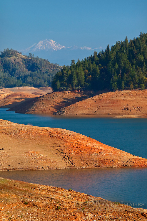Mount Lassen Volcano behind Shasta Lake Reservoir at one of it's lower levels during a drought year, near Redding, California