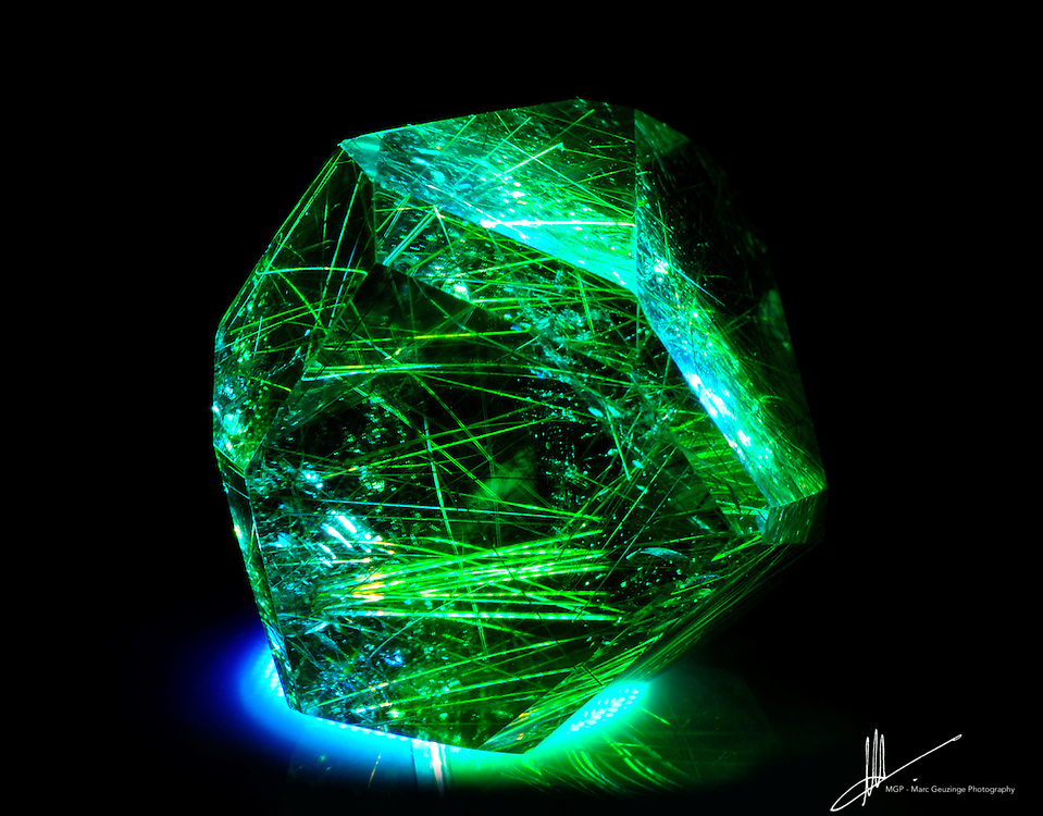 Samll Rutilated Quartz Illuminated in blue and green light.
