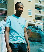 Teenager standing in front of a housing estate
