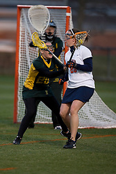 Virginia Cavaliers A Kate Breslin (20) in action against W&M.  The Virginia Cavaliers Women's Lacrosse team hosted the William and Mary Tribe at Kl?ckner Stadium in Charlottesville, VA on March 21, 2007.