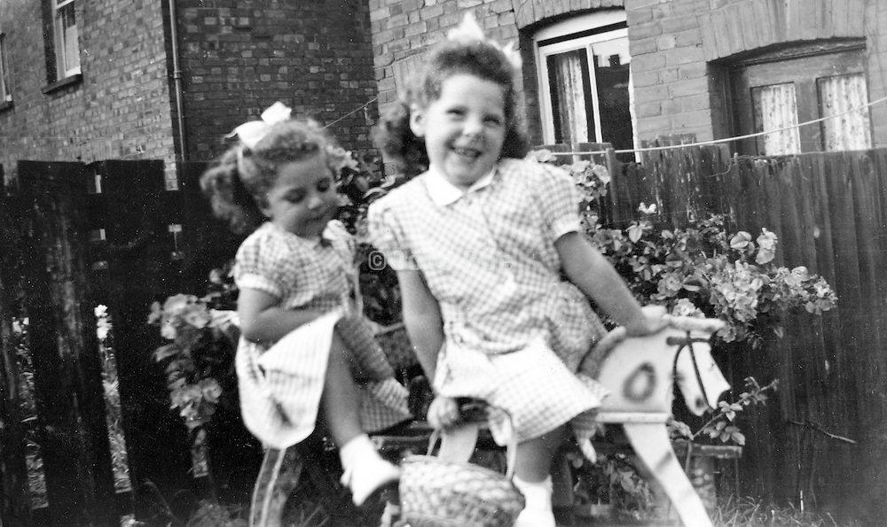 sister playing outside in the garden 1951 England