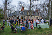 Annapolis, Maryland - April 18, 2015: Wedding guests mingle during Stephanie Shearer Cate and Winston Bao Lord's wedding at their friends Jeff and Marry Zients' house in Annapolis, Maryland Saturday April 18, 2015. <br /> <br /> <br /> <br /> CREDIT: Matt Roth for The New York Times<br /> Assignment ID: 30173318A