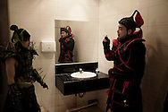 """Two """"soldiers"""" playing in the Beijing Opera """"Farewell My Concubine"""" meet in the opera bathroom for a clandestine smoke."""