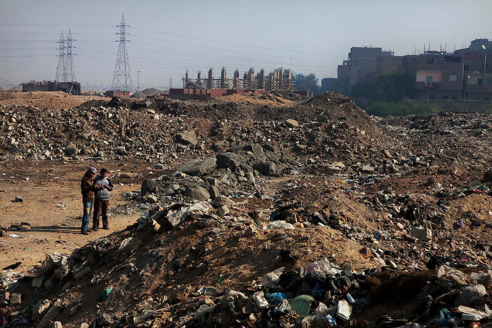 A zone designated for building rubble has slowly become a garbage dump to the dismay of the residents. They would like the local government to either stop people dumping garbage in their community or start picking it up regularly. .Cairo, Egypt.