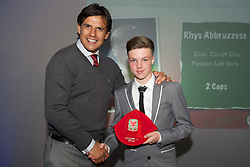 CARDIFF, WALES - Saturday, May 11, 2013: Rhys Abbruzzese is presented with his U16's cap by Wales national team manager Chris Coleman at the FAW Trust Under-16's cap presentation. (Pic by David Rawcliffe/Propaganda)