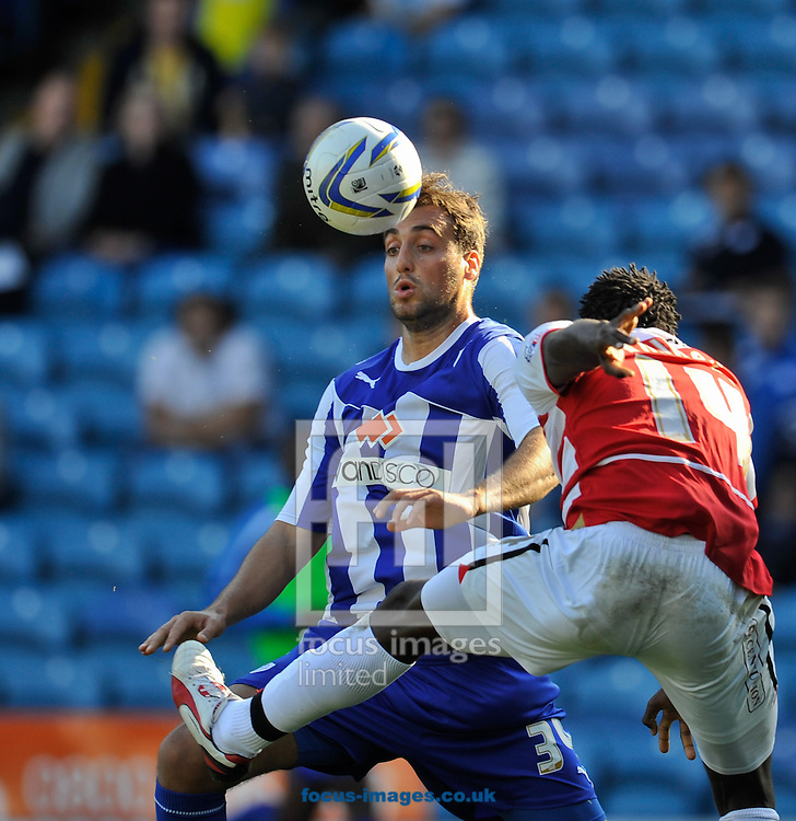 Picture by Richard Land/Focus Images Ltd +44 7713 507003<br /> 28/09/2013<br /> Atdhe Nuhiu of Sheffield Wednesday and Bongani Khumalo of Doncaster Rovers during the Sky Bet Championship match at Hillsborough, Sheffield.