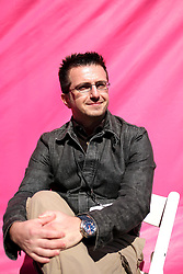 Dec 03 2007. New Orleans, Louisiana. Lower 9th Ward.<br /> Brad Pitt revisits the Lower 9th ward, devastated by Hurricane Katrina to present 'Make it Right' where architects' designs are unveiled to the public. One of the winning design Architects, Filo Castro of BNIM of Houston with a pink background for the pink project.<br /> Photo credit; Charlie Varley.
