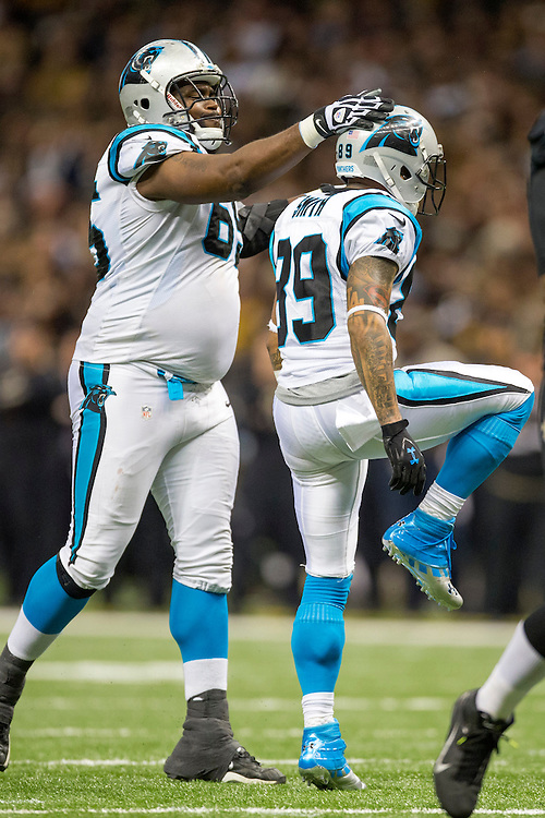 NEW ORLEANS, LA - DECEMBER 30:  Steve Smith #89 celebrates with Ricky Henry #65 of the Carolina Panthers after making a big catch against the New Orleans Saints at Mercedes-Benz Superdome on December 30, 2012 in New Orleans, Louisiana.  The Panthers defeated the Saints 44-38.  (Photo by Wesley Hitt/Getty Images) *** Local Caption *** Steve Smith; Ricky Henry