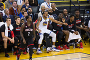 Golden State Warriors forward Andre Iguodala (9) falls into the Houston Rockets bench after a jump shot attempt at Oracle Arena in Oakland, Calif., on March 31, 2017. (Stan Olszewski/Special to S.F. Examiner)