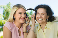Mother and Daughter Sharing Headphones