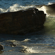 Wave crashing on rock. Zuma Point. Malibu, CA.USA.