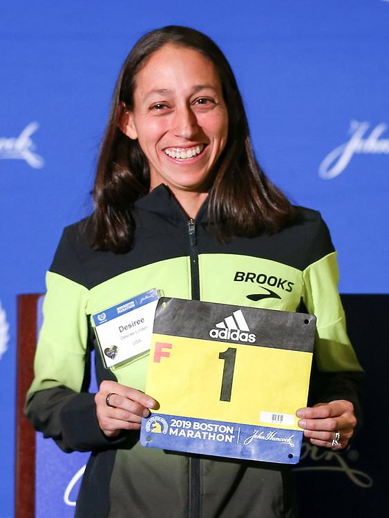 Des Linden, Yuki Kawauchi, defending champions, receive race bibs at press conference <br /> Boston Marathon weekend