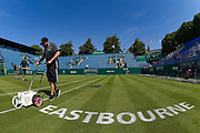 General view of groundsman painting the centre court lines during the Nature Valley International at Devonshire Park, Eastbourne, United Kingdom on 27 June 2018. Picture by Martin Cole.