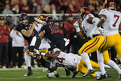 SANTA CLARA, CA - DECEMBER 05:  Quarterback Kevin Hogan #8 of the Stanford Cardinal is tackled by linebacker Olajuwon Tucker #34 of the USC Trojans during the first quarter of the Pac-12 Championship game at Levi's Stadium on December 5, 2015 in Santa Clara, California. The Stanford Cardinal defeated the USC Trojans 41-22. (Photo by Jason O. Watson/Getty Images) *** Local Caption *** Kevin Hogan; Olajuwon Tucker