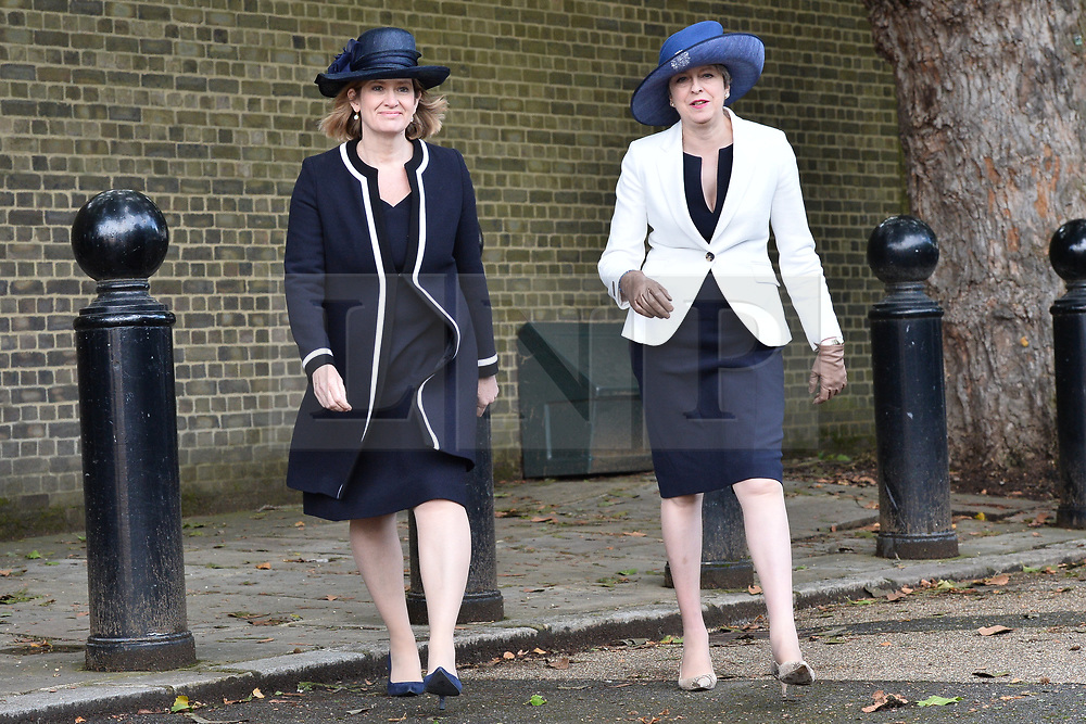 © Licensed to London News Pictures. 12/07/2017. London, UK. British Home Secretary Amber Rudd and British Prime Minister Theresa May attend the Ceremonial Welcome at Horse Guards Parade for His Majesty King Felipe VI of Spain and Her Majesty Queen Letizia during a three day State visit. Photo credit: Ray Tang/LNP