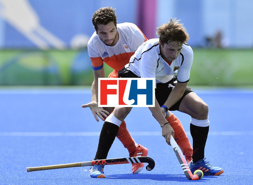 Netherlands' Valentin Verga (L) vies with Germany's Tobias Hauke during the men's Bronze medal field hockey Netherlands vs Germany match of the Rio 2016 Olympics Games at the Olympic Hockey Centre in Rio de Janeiro on August 18, 2016. / AFP / PHILIPPE LOPEZ        (Photo credit should read PHILIPPE LOPEZ/AFP/Getty Images)