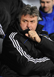 Guus Hiddink the Chelsea Manager looks on before the  the Barclays Premier League match between Portsmouth and Chelsea at Fratton Park on March 3, 2009 in Portsmouth, England.