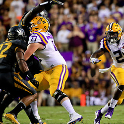 Oct 1, 2016; Baton Rouge, LA, USA;  LSU Tigers running back Darrel Williams (28) runs against the Missouri Tigers during the first quarter of a game at Tiger Stadium. Mandatory Credit: Derick E. Hingle-USA TODAY Sports