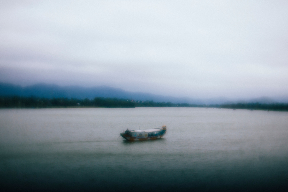 A boat crosses the Perfume River in Hue, Vietnam.