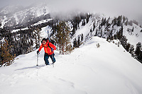 Mike Quigley hikes up Pioneer Peak to ski down, Wasatch Mountains Utah.