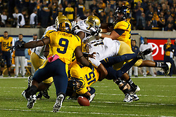 BERKELEY, CA - OCTOBER 06: Quarterback Zach Maynard #15 of the California Golden Bears fumbles the ball after being hit by linebacker Anthony Barr #11 of the UCLA Bruins during the first quarter at California Memorial Stadium on October 6, 2012 in Berkeley, California. The California Golden Bears defeated the UCLA Bruins 43-17. (Photo by Jason O. Watson/Getty Images) *** Local Caption *** Zach Maynard; Anthony Barr