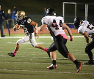 NEWTOWN, PA - OCTOBER 10: Council Rock South's Brendan Patterson #22 runs with the football in the second quarter s he is chased by William Tennent's Kenny Rickards #44 at Council Rock North's Walt Snyder Stadium October 10, 2014 in Newtown, Pennsylvania. (Photo by William Thomas Cain/Cain Images)